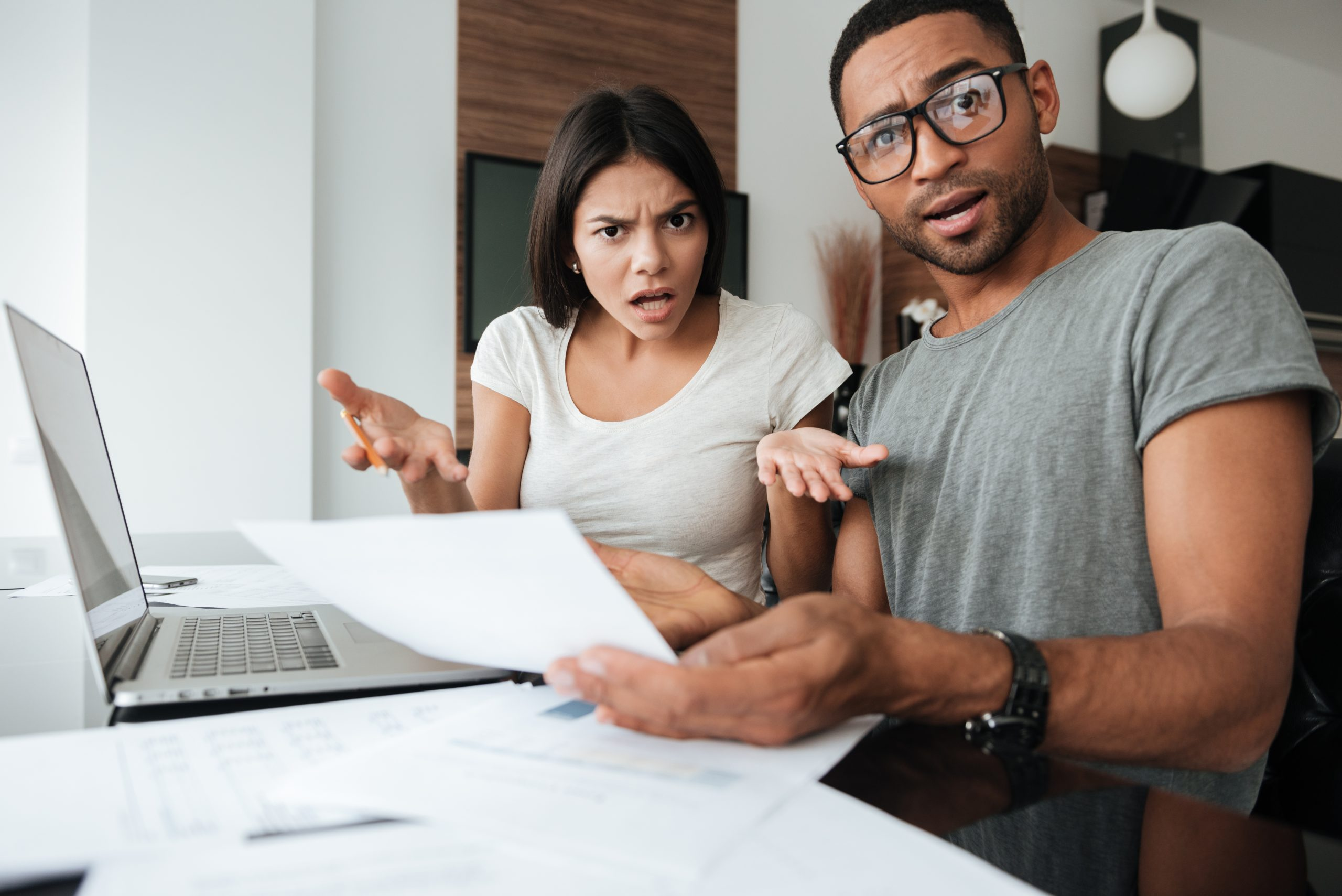 Picture of frustrated man and woman in front of a computer